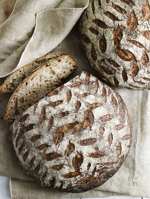Rustic loaves of whole grain bread with leaf pattern
