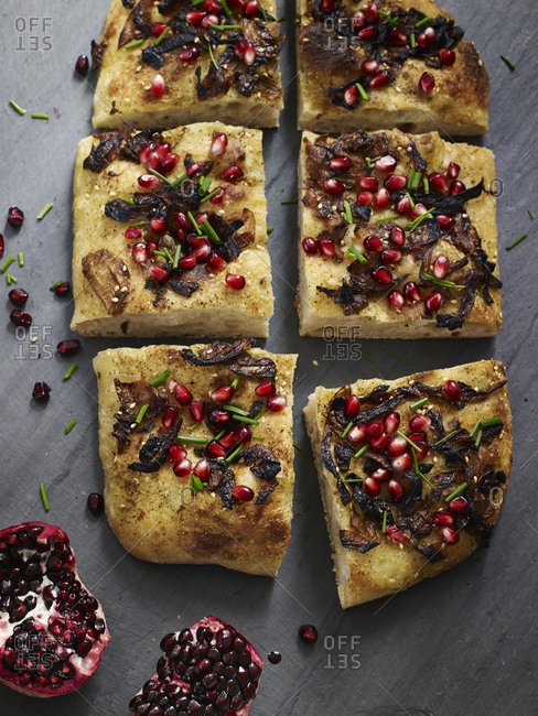 Slices of focaccia bread with pomegranate seeds