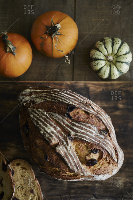 Loaf of freshly baked squash bread with raisins