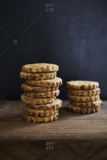 Stacks of sundried tomato shortbread on cutting board