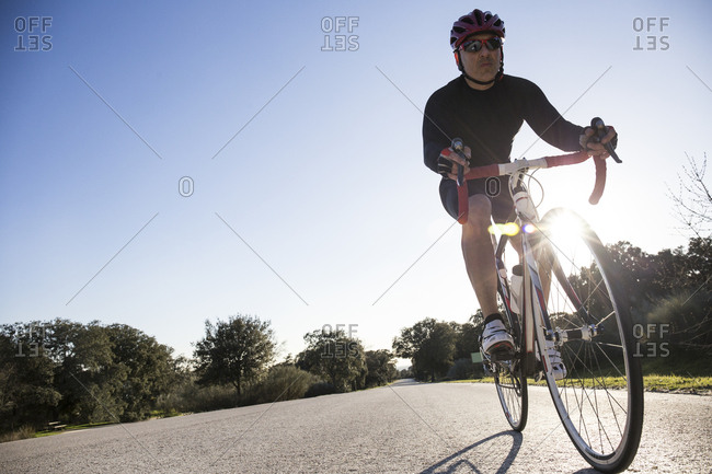 Man riding a bicycle through the countryside near Madrid, Spain