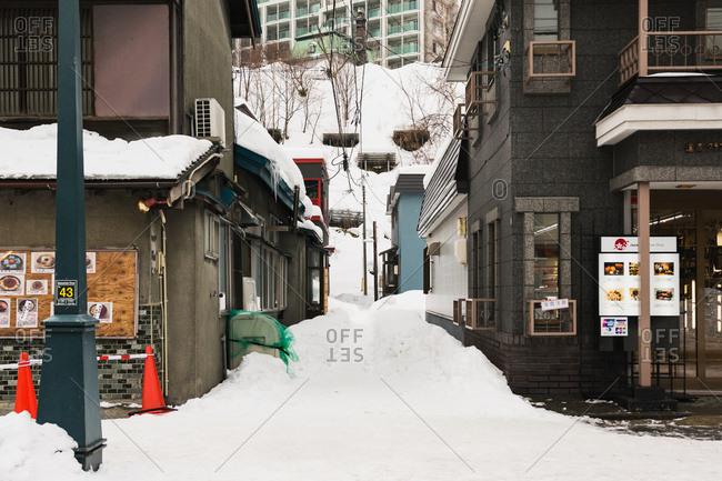 Otaru, Japan - January 9, 2017: Snow covered alley between buildings