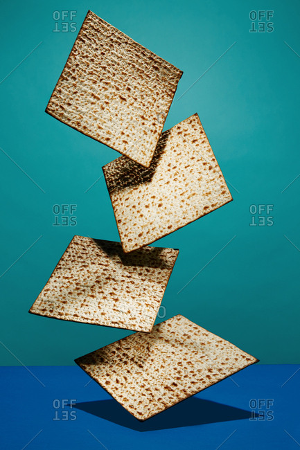 Line of matzo crackers on a blue background