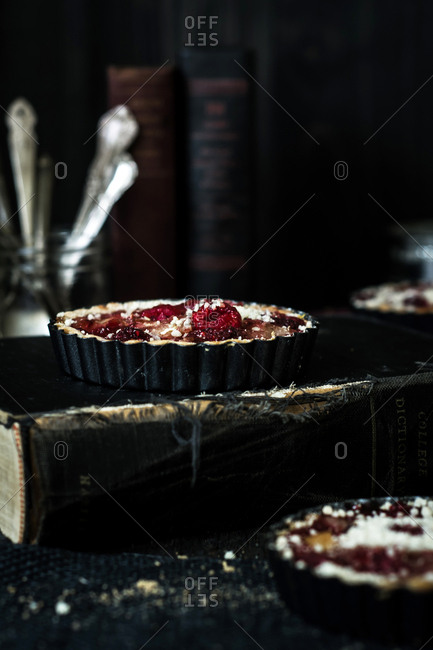Mini raspberry pies around book