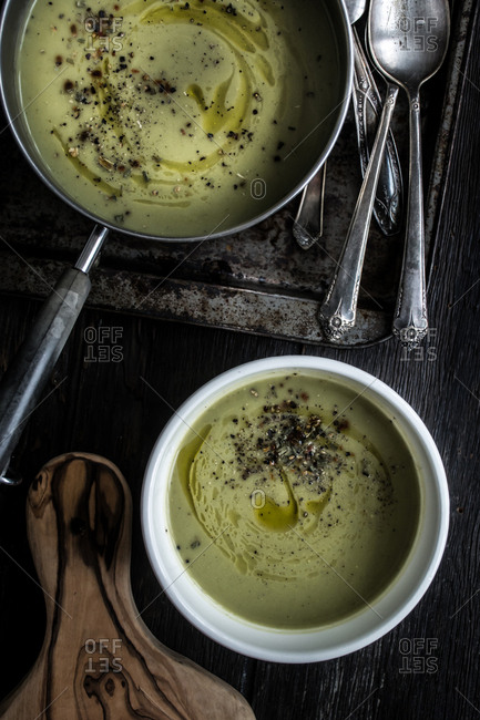 Zucchini soup in a pan and bowl