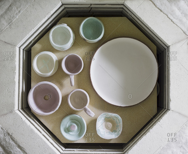 Overhead view of ceramics on table in workshop