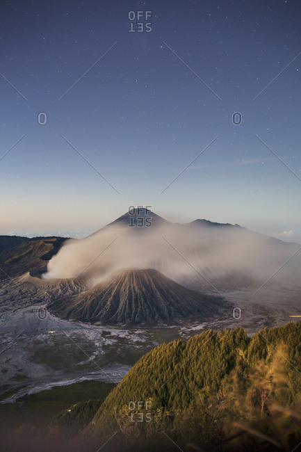 Scenic view of landscape against blue sky at Mount Bromo
