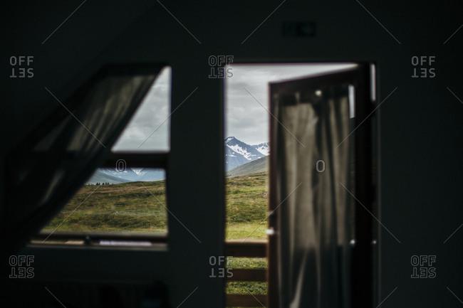Mountains seen through door