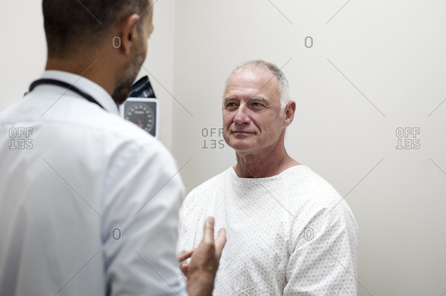 Doctor talking with patient in medical examination room