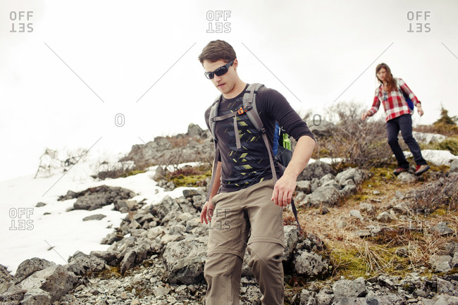 Low angle view of friends hiking on mountain