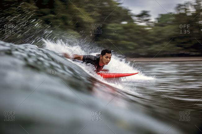 Man surfboarding in sea