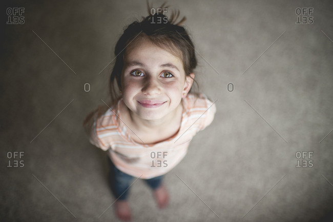 High angle portrait of smiling girl standing at home