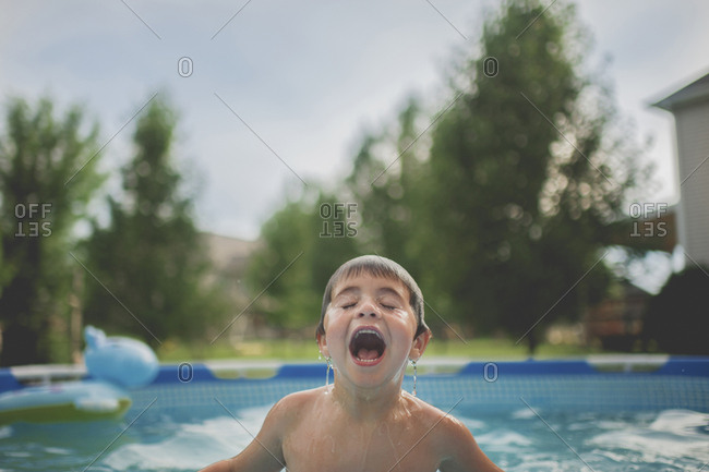 Boy swimming in wading pool