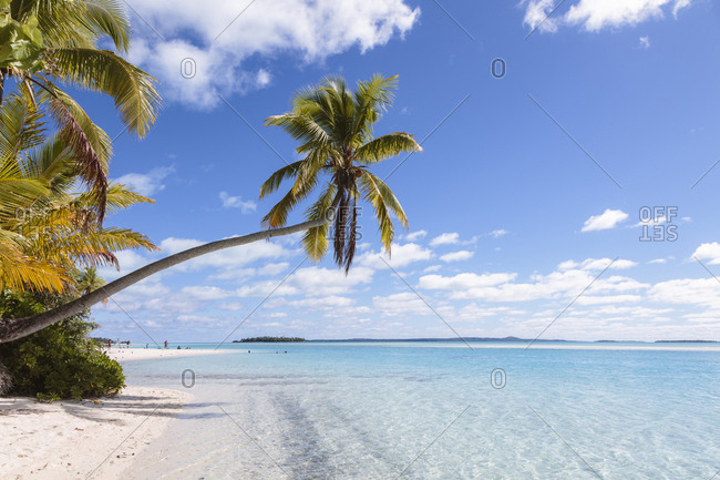Scenic view of Aitutaki lagoon against blue sky