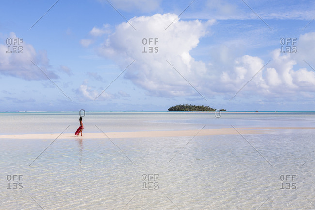 Side view of woman at beach against sky