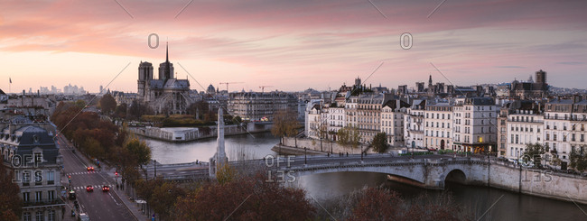 High angle view of bridge over Seine River against dramatic sky during sunset