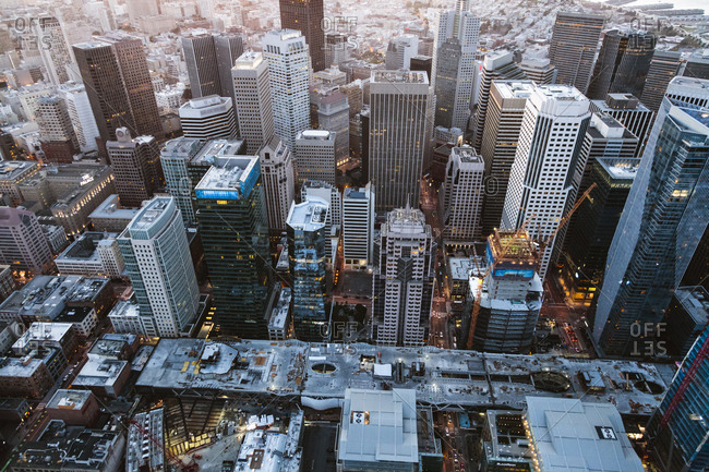 High angle view of modern buildings in city during sunset