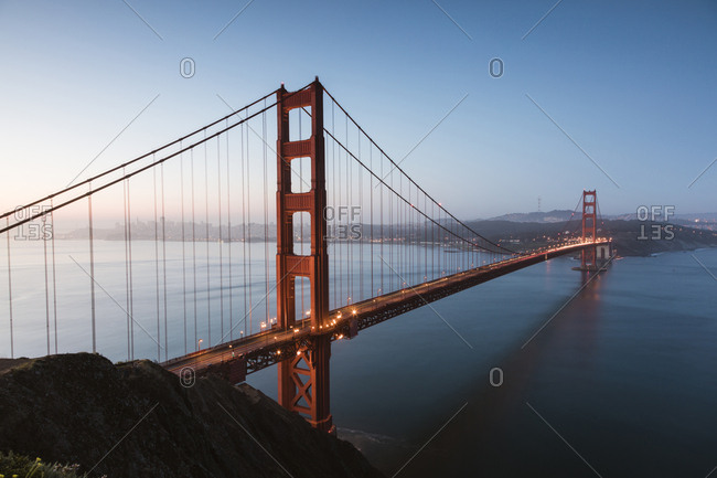 High angle view of Golden Gate Bridge over sea against clear blue sky