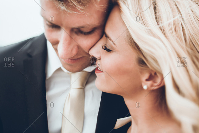 Close-up of bride and groom