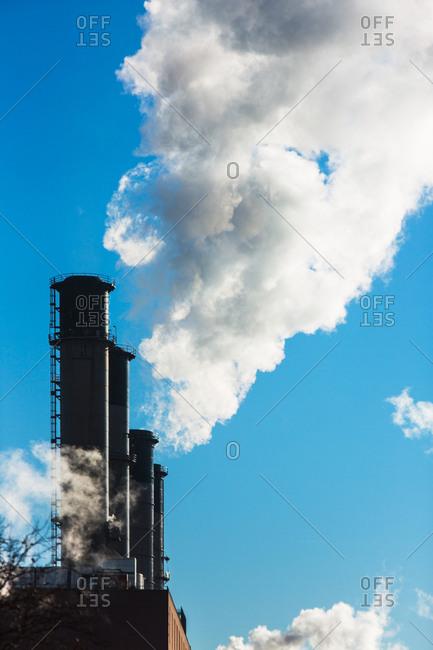 Smokestacks releasing smoke