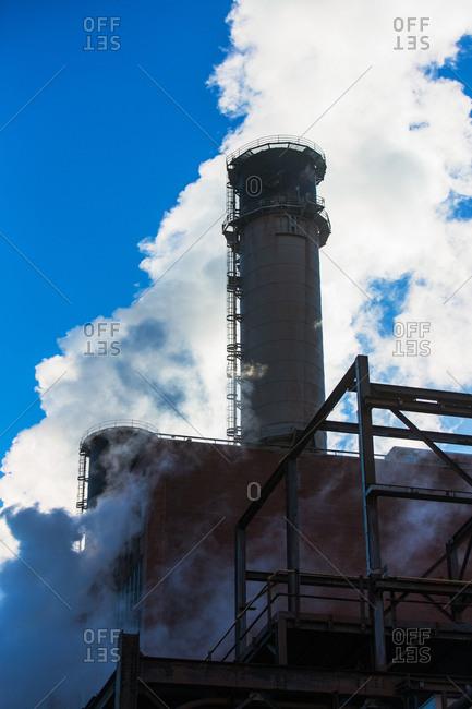 Smokestack releasing smoke