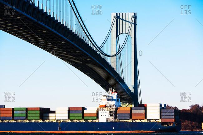 USA, New York State, New York City, Cargo ship under Verrazano narrows bridge