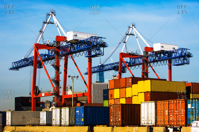 Cranes and cargo containers in dock
