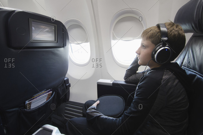 Boy watching TV in aero plane