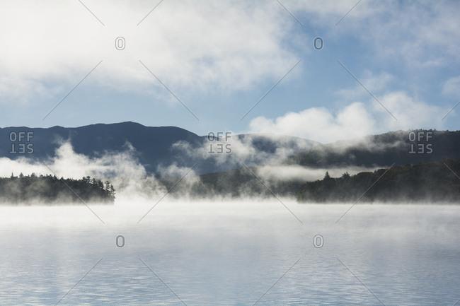 USA, New York State, Fog above Lake Placid