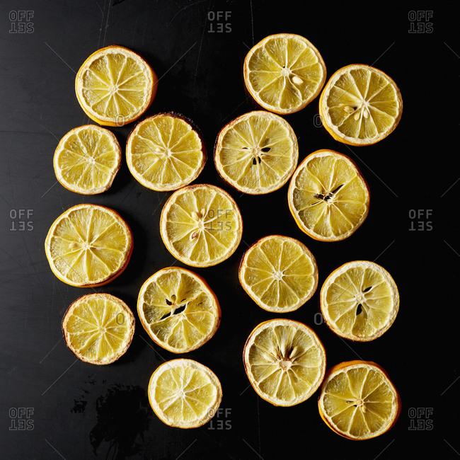 Dried lemon slices on black background