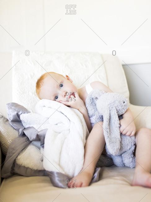 Baby boy holding stuffed rabbit