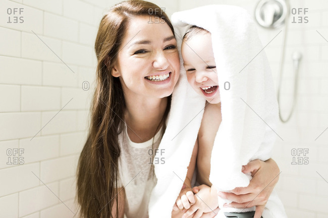 Mother and son laughing in bathroom