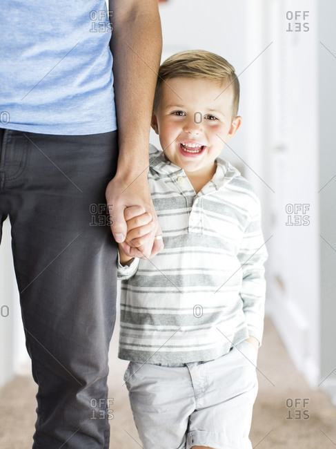 Father and son standing in corridor