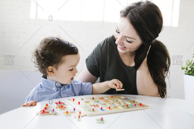 Mother playing alphabet game with son