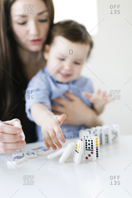 Mother playing domino game with son