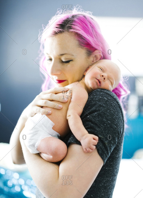 Mother embracing newborn son