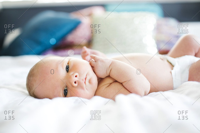 Baby boy lying in bed