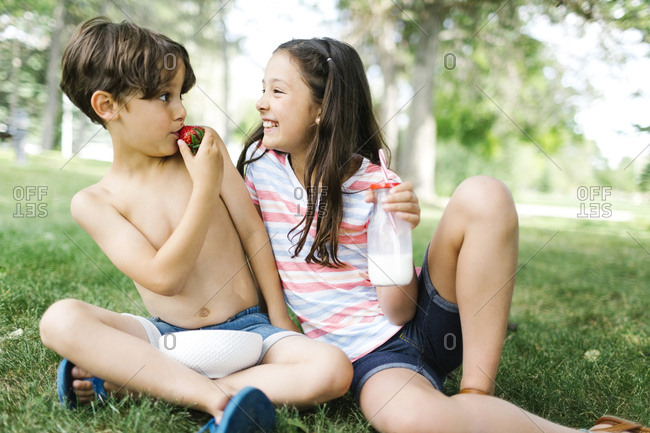 Portrait of sister and brother having fun on picnic