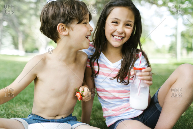 Portrait of sister and brother on picnic