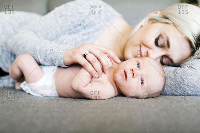 Portrait of newborn boy months with mother