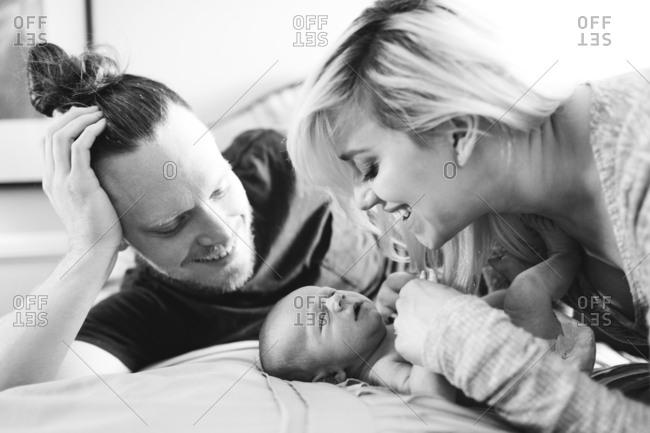 Portrait of parents with newborn boy months