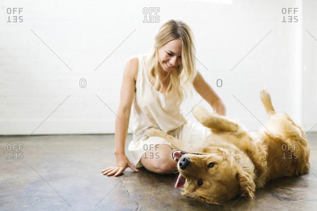 Woman stroking dog