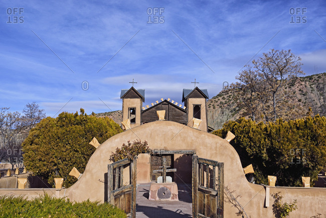 USA, New Mexico, Chimayo, El Santuario de Chimayo among trees and mountains