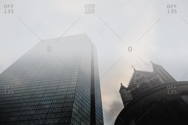 USA, Massachusetts, Boston, John Hancock Tower and Trinity Church at Copley Square in fog