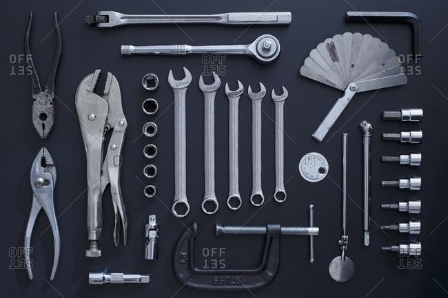 Studio shot of work tools on black background