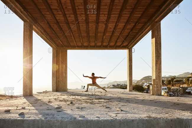 Greece - February 27, 2017: Man doing yoga