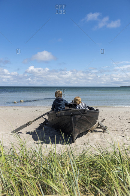 Children in rowing boat on beach
