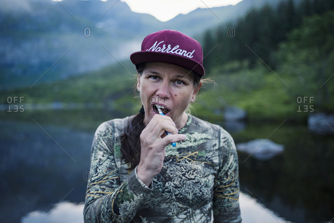 Hiker brushing teeth - Offset Collection