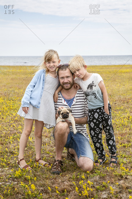 Portrait of father with two children