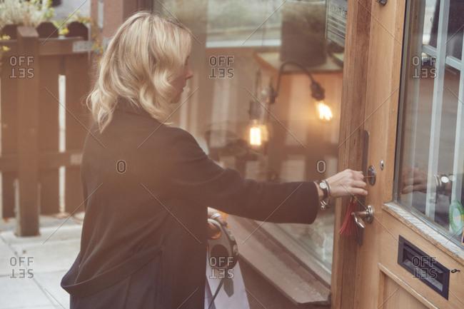 Woman closing shop